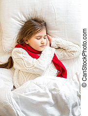 portrait of little girl in sweater sleeping at bed