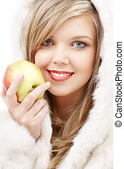 lovely blond in fur with apple - closeup portrait of lovely...