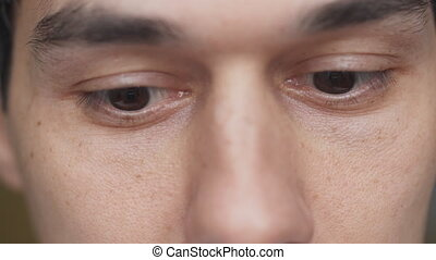 Closeup portrait of man with brown eyes in process of...