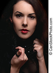 Closeup portrait of passionate young lady. Isolated