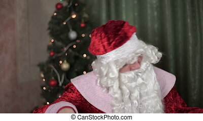 Closeup portrait of Santa Claus dances, new year, christmas