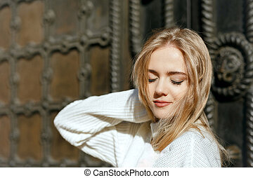 Closeup portrait of sensual model with natural makeup posing with closed eyes. Space for text