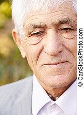 Closeup portrait of serious senior man