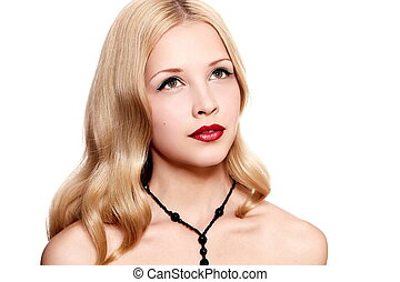 closeup portrait of sexy blond caucasian young woman model with glamour red lips,bright makeup, eye arrow makeup, purity complexion. Perfect clean skin.