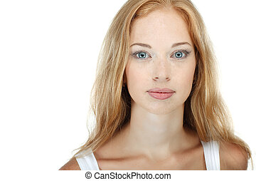 Closeup portrait of sexy redheaded young woman with beautiful blue eyes on white background
