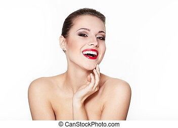 closeup portrait of sexy smiling caucasian young woman model with glamour red lips, bright makeup, eye arrow makeup, purity complexion. Perfect clean skin. white teeth