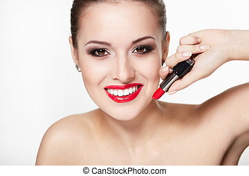 closeup portrait of sexy smiling caucasian young woman model with glamour red lips,bright makeup, eye arrow makeup, purity complexion with red lipstick. Perfect clean skin.white teeth