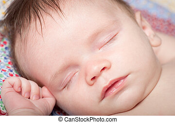 Closeup portrait of sleeping baby boy