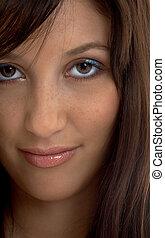 closeup portrait of smiling brunette