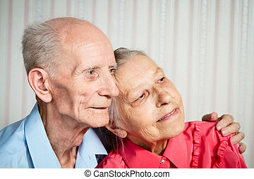 Closeup portrait of smiling elderly couple