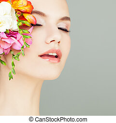 Closeup Portrait of Spa Woman. Healthy Skin and Flowers