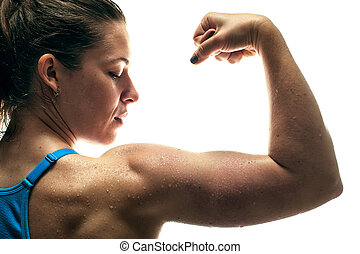 Fitness female showing biceps muscles