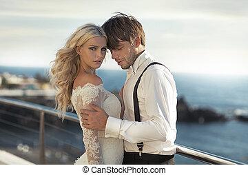 Closeup portrait of the attractive newlyweds - Closeup...
