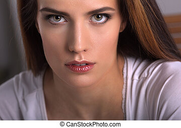 Closeup portrait of the pretty young woman