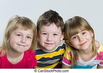 Closeup portrait of three cheerful children