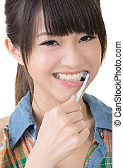 Closeup portrait of woman brushing teeth
