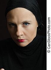 Closeup portrait of woman in black