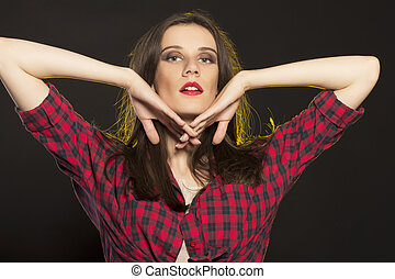 Closeup portrait of woman red checked shirt