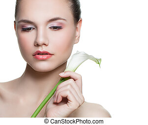 Closeup portrait of young beautiful woman with white flower isolated on white