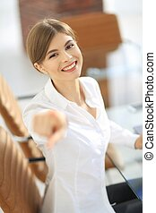 closeup portrait of young business woman at the workplace