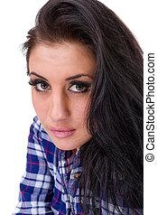 closeup portrait of young dreamy woman
