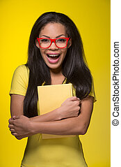 Closeup portrait of young laughing woman. student wearing red glasses, holding book