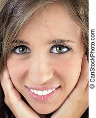 Closeup Portrait of young smiling teen girl