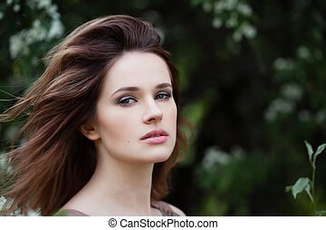 Closeup portrait of young woman face outdoors