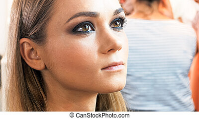 Closeup portrait of young woman with professional smokey ...