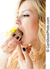 closeup portrait picture of eating alone large fruit creamy cake beautiful blond young lady cute green eyes girl having fun enjoying eyes closed on light copy space background