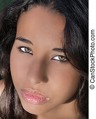 Closeup portrait young mixed woman green eyes