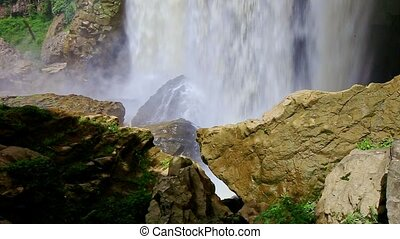 Closeup Powerful  Waterfall Bottom with Mist among Rocks
