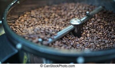 Closeup process of roasting fresh fried coffee beans. ...