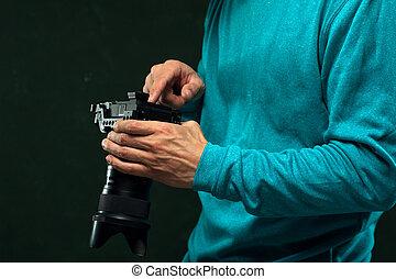 Closeup professional photographer with camera