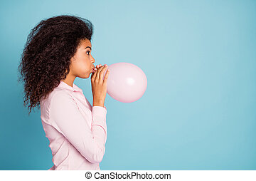 Closeup profile photo of pretty dark skin lady holding hands big air balloon preparing decorations for surprise birthday party wear pink shirt isolated blue color background