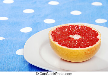 red grapefruit on a plate