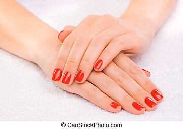 red manicure on the white towel - Closeup red manicure on...