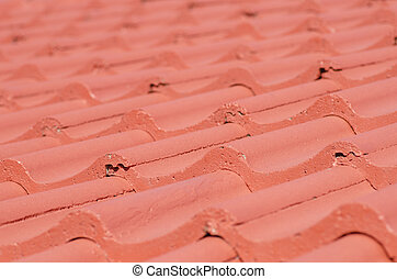 Closeup red roof tiles blurred background
