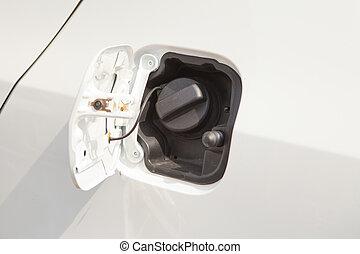 Closeup refuel gasoline on white car
