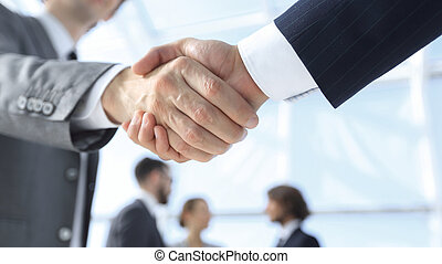 closeup. reliable handshake of business partners on the ...