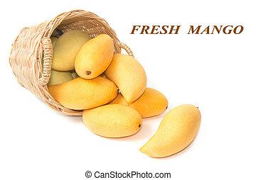 closeup ripe mangoes in basket