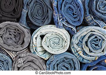 Closeup rolled of blue jeans pants, dark blue denim trousers