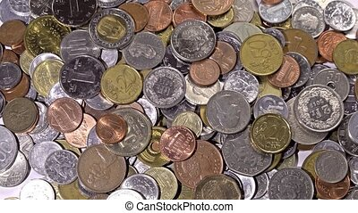 rotating of metal coins of different currencies - closeup ...