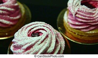 closeup row of pink zephyr on black background - closeup...