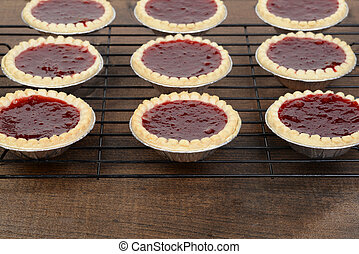 rows of strawberry tarts