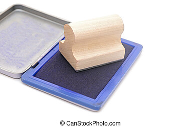 closeup rubber stamp with stamp pad on white background