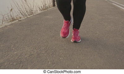 closeup Runner women's running seaside. athlete fitness...