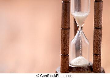 closeup sandglass on wood background