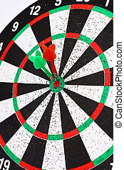 closeup. several Arrows dart hitting the center of the target d
