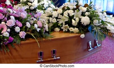 closeup shot of a colorful casket in a hearse or chapel...